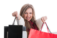 Smiling shopping girl showing shopping bags Royalty Free Stock Images