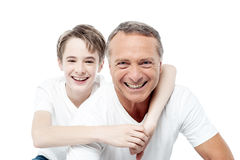 Smiling shot of a father and son. Father with son happy smiling over white background Royalty Free Stock Photo