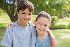 Smiling sibling looking at camera in the park Stock Photography
