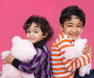 Smiling Siblings CLutching Their Stuffed Toys Royalty Free Stock Image