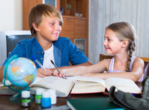 Smiling siblings kids doing homework Royalty Free Stock Images