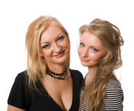 Smiling similar sisters isolated Stock Photography