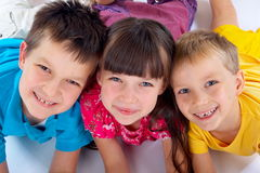 Smiling sister with brothers. White background Royalty Free Stock Image