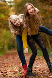 Smiling sisters in the forest royalty free stock photos