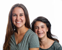 Smiling sisters hanging together. Royalty Free Stock Photo