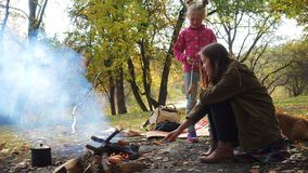 Smiling sisters on picnic in  autumn forest. Smiling sisters on picnic in the autumn forest stock footage