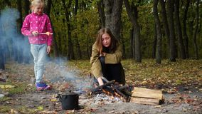 Smiling sisters on picnic in  autumn forest. Smiling sisters on picnic in the autumn forest stock video