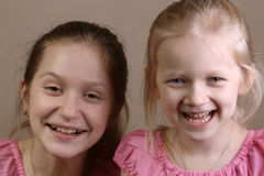 Smiling sisters Stock Image