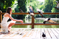 Smiling sit with doves Royalty Free Stock Photo
