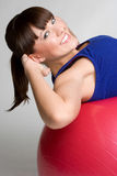 Smiling Situps Girl. Pretty smiling girl doing situps Royalty Free Stock Photos