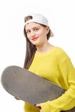 Smiling skater girl holding skateboard on white Stock Images
