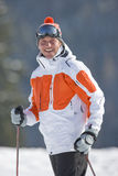 Smiling skier in cap and goggles Stock Photography