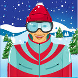 Smiling skier with ski goggles Stock Images