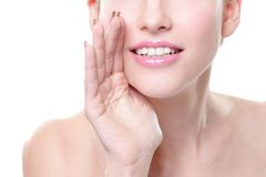 Smiling Skin care woman whisper Royalty Free Stock Photography