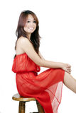 Smiling Skinny Attractive Asian American Woman Sitting Royalty Free Stock Images