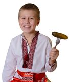 Smiling slavic boy with fork Royalty Free Stock Images