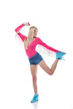 Smiling slender blonde posing in sports wear Stock Photo