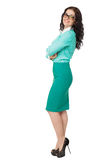Smiling slim brunette girl in green skirt and blouse wearing gla Royalty Free Stock Image