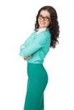 Smiling slim brunette girl in green skirt and blouse wearing gla Stock Photos