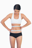 Smiling slim woman measuring her waist Royalty Free Stock Photos