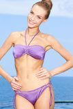 Smiling Slim Woman Posing in Sexy Violet Swim Wear Stock Image