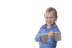 Smiling boy with touch pad Stock Images