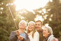 Smiling small family taking selfies Stock Photography