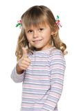 Smiling small girl with her thumb up Royalty Free Stock Photo