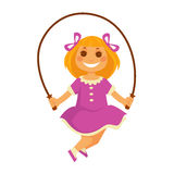 Smiling small girl jumps with skipping rope isolated on white Stock Photos