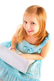 Smiling small girl working with computer Stock Images