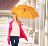 Smiling smart woman with the umbrella Royalty Free Stock Photography