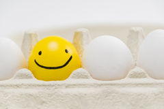 Smiling smile egg in white box Royalty Free Stock Images