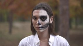 Halloween. Smiling girl with dead man makeup. Smiling Smiling girl with dead man makeup. Halloween holiday. All Saints` Night. Halloween concept. Best Halloween stock footage