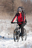 Smiling snow biker. On the sunset Royalty Free Stock Photography