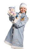 Smiling snow maiden with bear toy Stock Image
