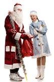 Smiling snow maiden and Santa Claus Royalty Free Stock Photos