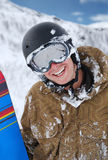 Smiling snowboarder with snowboard Royalty Free Stock Photos
