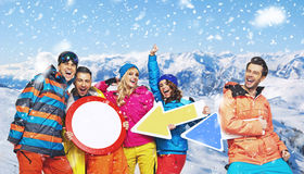 Smiling snowboarders in a funny poses Royalty Free Stock Photography