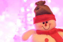 Smiling snowman against christmas lights Royalty Free Stock Image