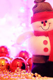 Smiling snowman against christmas lights Royalty Free Stock Images