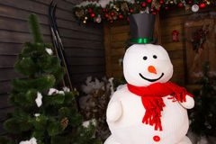 Smiling Snowman With Black Hat and Red Scarf Royalty Free Stock Photography