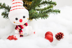 Smiling snowman with christmas decoration and christmas tree Royalty Free Stock Photography