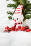 Smiling snowman with christmas decoration and christmas tree Stock Photo