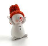 Smiling snowman figurine on white background Royalty Free Stock Image
