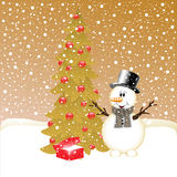 Smiling snowman near fir tree and gifts. Smiling snowman near fir tree Royalty Free Stock Photography