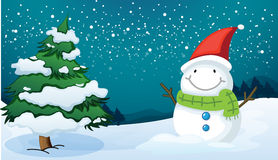 A smiling snowman near the pine tree Royalty Free Stock Photos