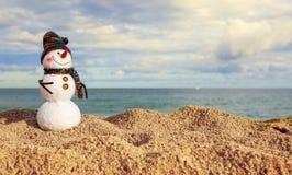Smiling snowman on the sea beach Royalty Free Stock Photos