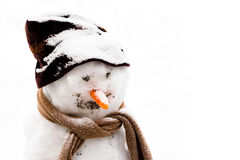 Smiling snowman in the snow Stock Images