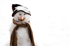 Smiling snowman in the snow Stock Photography