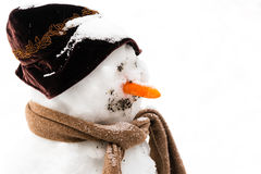 Smiling snowman in the snow Royalty Free Stock Photography